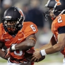 FILE - In this Nov. 17, 2012, file photo, Illinois' Nathan Scheelhaase (2) hands off the ball to running back Josh Ferguson (6) during an NCAA college football game against Purdue in Champaign, Ill. Coming off a 2-10 season, there will be changes in Tim Beckman's second season as Illinois coach. Spring practice starts Tuesday, March 5, 2013. Beckman says the team's running backs figure to be a strong point. Ferguson, Donovonn Young and Dami Ayoola combined for 1,000 yards on 232 carries last season. (AP Photo/Stephen Haas, File)