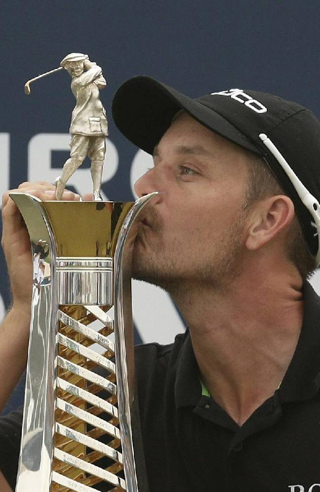 Henrik Stenson from Sweden kisses the European tour race trophy after the final round of DP World Golf Championship, in Dubai, United Arab Emirates, Sunday, Nov. 17, 2013