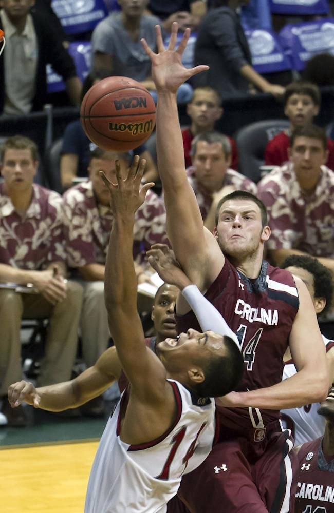 St. Mary's guard Stephen Holt (14) attempts layup but is fouled by South Carolina forward Laimonas Chatkevicius (14) in the second half of an NCAA college basketball game at the Diamond Head Classic Sunday, Dec. 22, 2013, in Honolulu. South Carolina beat Saint Mary's 78-71