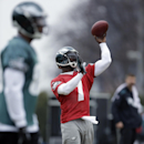 Philadelphia Eagles quarterback Michael Vick throws a pass during practice at the NFL football team's training facility, Thursday, Dec. 5, 2013, in Philadelphia The Associated Press