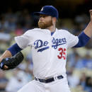 Los Angeles Dodgers starting pitcher Brett Anderson throws to the Oakland Athletics during the first inning of a baseball game in Los Angeles, Tuesday, July 28, 2015. (AP Photo/Chris Carlson)