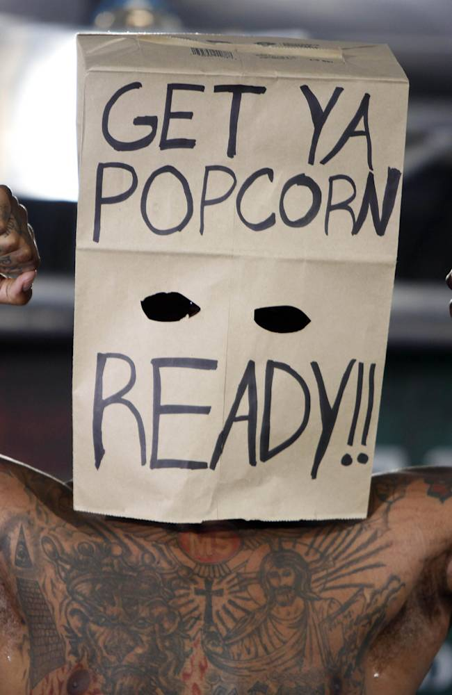 In this Friday, March 14, 2014 photo, boxer Malik Scott wears a paper bag over his head as he poses for photos during the official weigh-in in Bayamon, Puerto Rico. Scott lost his bout with WBC Continental Americas Heavyweight Champion Deontay Wilder in a Showtime Championship Boxing match on Saturday