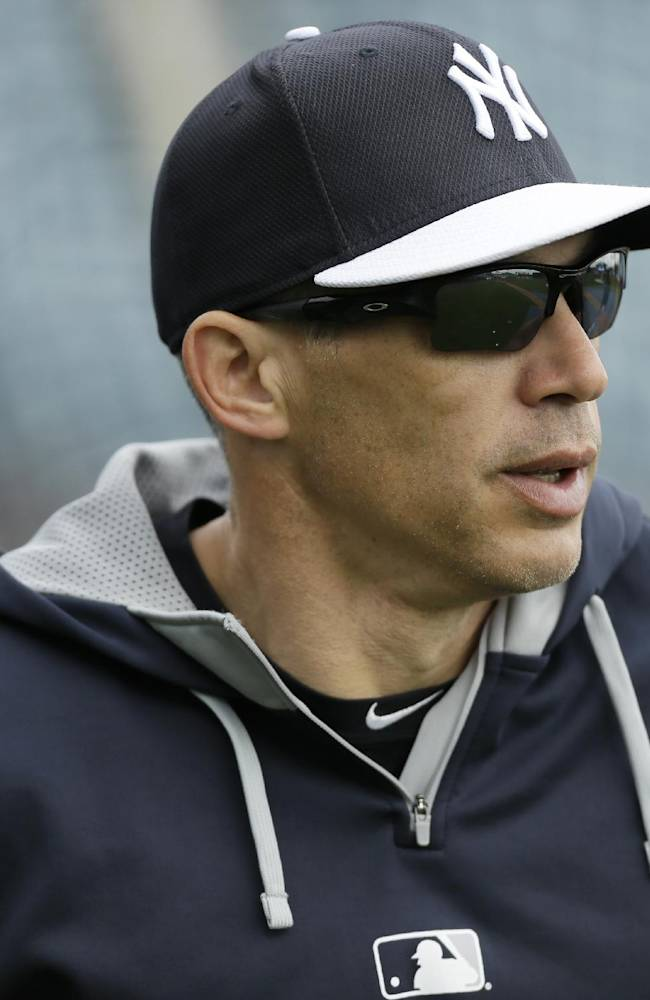 New York Yankees manager Joe Girardi watches his team take batting practice before an exhibition baseball game against the Pittsburgh Pirates Thursday, Feb. 27, 2014, in Tampa, Fla