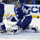Tampa Bay Lightning goalie Ben Bishop watches a goal by Montreal Canadiens' Brendan Gallagher go past him during the first period of an NHL hockey game Monday, Oct. 13, 2014, in Tampa, Fla The Associated Press