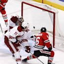 Chicago Blackhawks left wing Teuvo Teravainen (86) scores past Arizona Coyotes center Martin Hanzal (11) and goalie Mike Smith (41) during the second period of an NHL hockey game Tuesday, Jan. 20, 2015, in Chicago The Associated Press