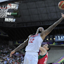 DeMarcus Cousins of the U.S, left, shoots over Mexico's Adrian Zamora during Basketball World Cup Round of 16 match between United States and Mexico at the Palau Sant Jordi in Barcelona, Spain, Saturday, Sept. 6, 2014. The 2014 Basketball World Cup competition will take place in various cities in Spain from Aug. 30 through to Sept. 14. (AP Photo/Manu Fernandez)