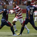 Cuba's Joel Colome (L) and Jaine Valencia defend against Edgar Castillo (C) of the U.S. during their CONCACAF Gold Cup soccer match in Salt Lake City, Utah July 13, 2013. REUTERS/Jim Urquhart