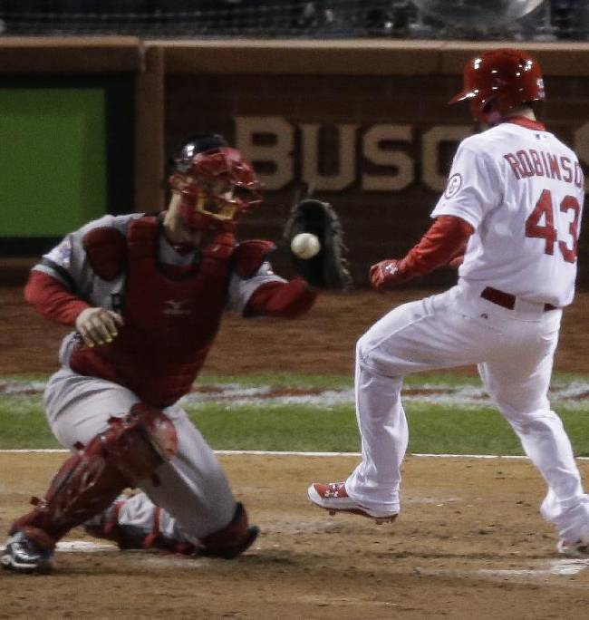 St. Louis Cardinals' Shane Robinson scores as Boston Red Sox catcher David Ross takes the throw during the seventh inning of Game 4 of baseball's World Series Sunday, Oct. 27, 2013, in St. Louis. Robinson scored on a hit by Matt Carpenter