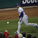 Los Angeles Dodgers' Carl Crawford chases down a double hit by St. Louis Cardinals' Carlos Beltran during the first inning of Game 6 of the National League baseball championship series Friday, Oct. 18, 2013, in St. Louis The Associated Press