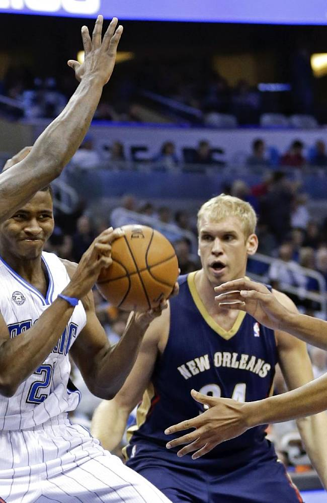 Orlando Magic's Maurice Harkless, second from left, tries to pass the ball as he finds himself pressured by New Orleans Pelicans' Anthony Morrow (3), Greg Stiemsma, center, and Anthony Davis during the first half of an NBA basketball game in Orlando, Fla., Friday, Nov. 1, 2013