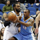 Denver Nuggets's Darrell Arthur, right, gets a pass as Minnesota Timberwolves' Ronny Turiaf, of France, defends in the first quarter of an NBA basketball game Wednesday, Feb. 12, 2014, in Minneapolis The Associated Press