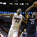 Charlotte Bobcats' Al Jefferson (25) takes a pass from a teammate over Miami Heat's Udonis Haslem (40) during the second half in Game 1 of an opening-round NBA basketball playoff series on Sunday, April 20, 2014, in Miami. The Heat defeated the Bobcats 99-88. (AP Photo/Lynne Sladky)