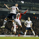 Tottenham's Kyle Walker, leaps for the ball with Sheffield United's Stefan Scougall during their English League Cup semifinal 1st leg soccer match between Tottenham Hotspur and Sheffield United, at the White Hart Lane stadium in London, Wednesday, Jan 21,