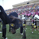 In this Saturday, Oct. 26, 2013, file photo, Grambling State cheerleaders perform their routines in the second half of an NCAA college football game against Texas Southern, in Grambling, La. After a turmoil-filled 2013 season, the Grambling football team