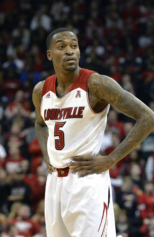 Louisville's Kevin Ware looks to the bench during the second half of their NCAA college basketball game Friday Nov. 29, 2013, in Louisville, Ky. Louisville defeated So. Mississippi 69-38