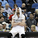 Minnesota Timberwolves forward Kevin Love sits on the advertisement stand during a timeout in the fourth quarter of the Timberwolves' NBA basketball game against the Chicago Bulls in Minneapolis, Wednesday, April 9, 2014. Despite Love's team-high 17 point