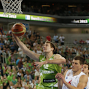 Slovenia's Zoran Dragic, left, leaps for a basket past Serbia's Nemanja Nedovic, right, during their EuroBasket European Basketball Championship classification 5th to 8th place play off match in Ljubljana, Slovenia, Thursday, Sept. 19, 2013. (AP Photo/Petr David Josek)