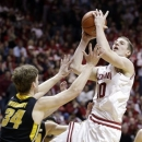 Indiana forward Cody Zeller, right, shoots over Iowa center Adam Woodbury in the second half of an NCAA college basketball game in Bloomington, Ind., Saturday, March 2, 2013. Indiana defeated Iowa 73-60/ (AP Photo/Michael Conroy)