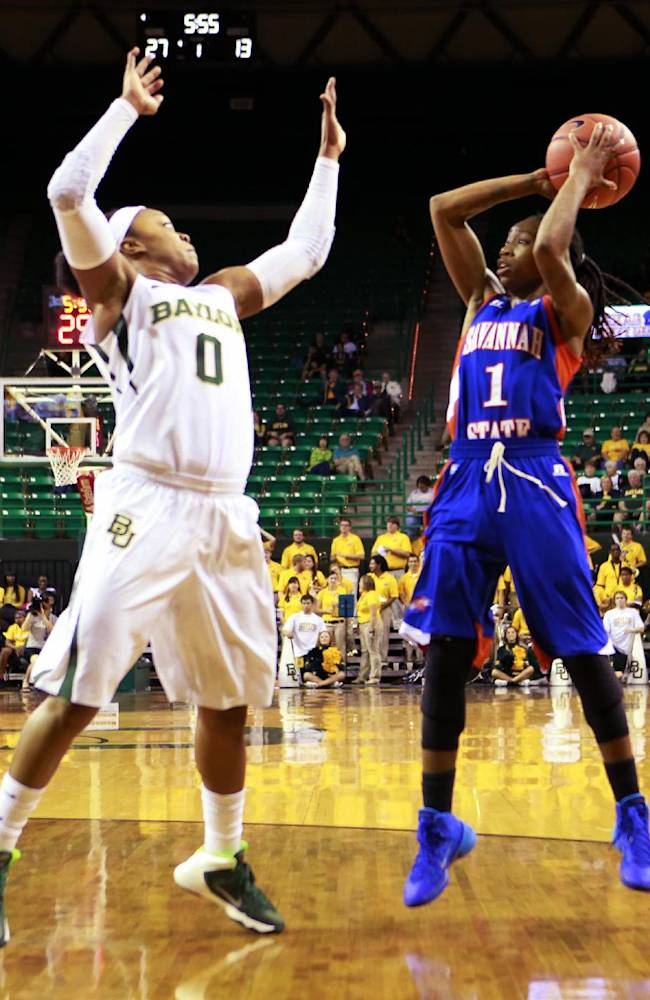 Baylor guard Odyssey Sims (0) defend against Savannah State guard Bria Dorsey (1)  during second half of an NCAA college basketball game, Thursday, Nov. 21, 2013, in Waco, Texas.   Baylor won 99-31
