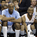 From the left, Charlotte Bobcats' Gerald Henderson, Anthony Tolliver, Kemba Walker, Michael Kidd-Gilchrist cheer their teammates from the bench during their 116-98 win over the Detroit Pistons in an NBA basketball game in Charlotte, N.C., Wednesday, Feb.