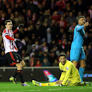 Sunderland's Adam Johnson, left, celebrates his goal as Tottenham Hotspurs' goalkeeper Hugo Lloris, center, looks on during their English Premier League soccer match at the Stadium of Light, Sunderland, England, Saturday, Dec. 7, 2013