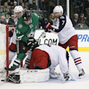 Dallas Stars' Tyler Seguin (91) fights for a loose puck as Columbus Blue Jackets goalie Sergei Bobrovsky, Matt Calvert (11) and Jack Johnson (7) defend the net in the first period of an NHL hockey game, Tuesday, Jan. 6, 2015, in Dallas The Associated Pres