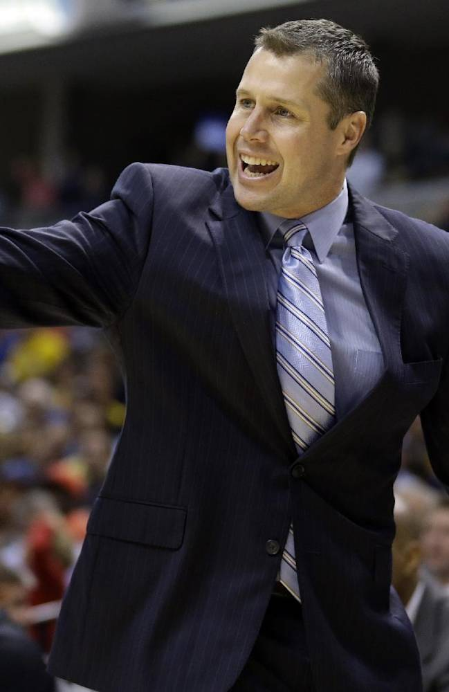 Memphis Grizzlies head coach David Joerger yells to his team as they played the Indiana Pacers in the first half of an NBA basketball game in Indianapolis, Monday, Nov. 11, 2013