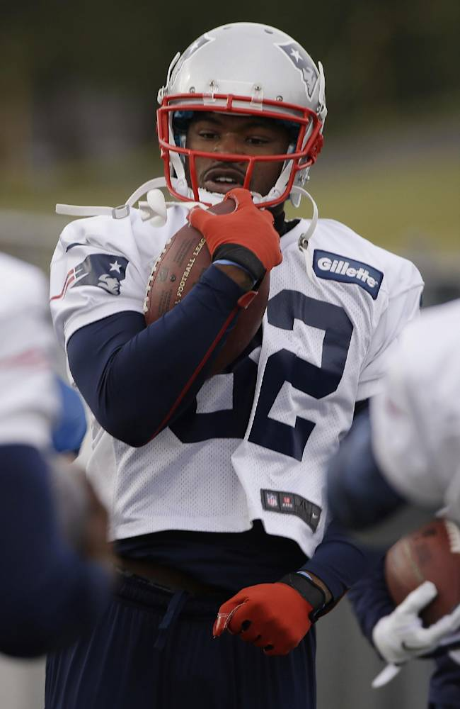 New England Patriots wide receiver Josh Boyce (82) carries a ball during a drills and stretching session before practice begins at the NFL football team's facility in Foxborough, Mass., Wednesday, Dec. 4, 2013. The Patriots will face the Cleveland Browns on Sunday in Foxborough
