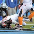 Tampa Bay Buccaneers' Josh McCown (12) dives into the end zone in front of Carolina Panthers' Thomas Davis (58) for a touchdown in the second half of an NFL football game in Charlotte, N.C., Sunday, Dec. 14, 2014 The Associated Press