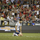 Los Angeles Galaxy's Tommy Meyer kneels on the field after Manchester United's Wayne Rooney scored during the first half of a friendly soccer match at the Rose Bowl on Wednesday, July 23, 2014, in Pasadena, Calif. (AP Photo)