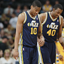 Utah Jazz guard Alec Burks, front, and forward Jeremy Evans head off the court after the Denver Nuggets' 101-94 victory over the Jazz in an NBA basketball game in Denver on Saturday, April 12, 2014 The Associated Press