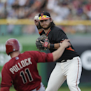 San Francisco Giants shortstop Brandon Crawford throws to first to complete a double play as Arizona Diamondbacks' A.J. Pollock slides in to second during the third inning of a spring training baseball game Sunday, March 2, 2014, in Scottsdale, Ariz The A