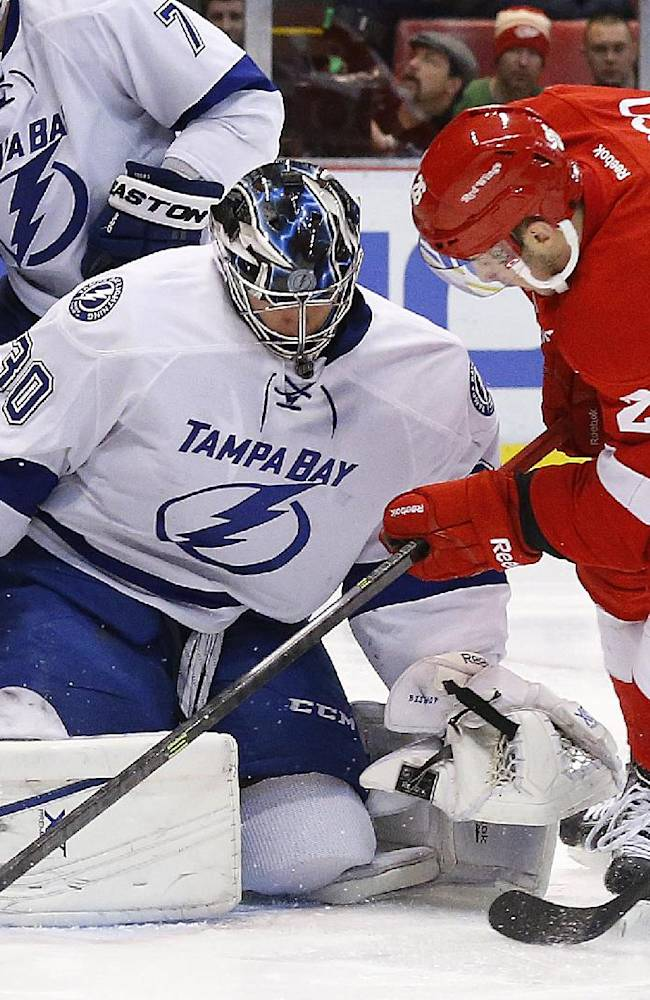 Tampa Bay Lightning goalie Ben Bishop (30) stops a Detroit Red Wings right wing Tomas Jurco (26), of Slovakia, shot in the second period of an NHL hockey game in Detroit, Sunday, Dec. 15, 2013