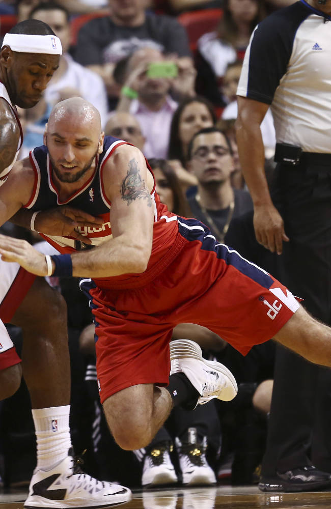 Washington Wizards' Marcin Gortat, right, tries to steal the ball from Miami Heat's LeBron James (6) during the first half of an NBA basketball game in Miami, Sunday, Nov. 3, 2013