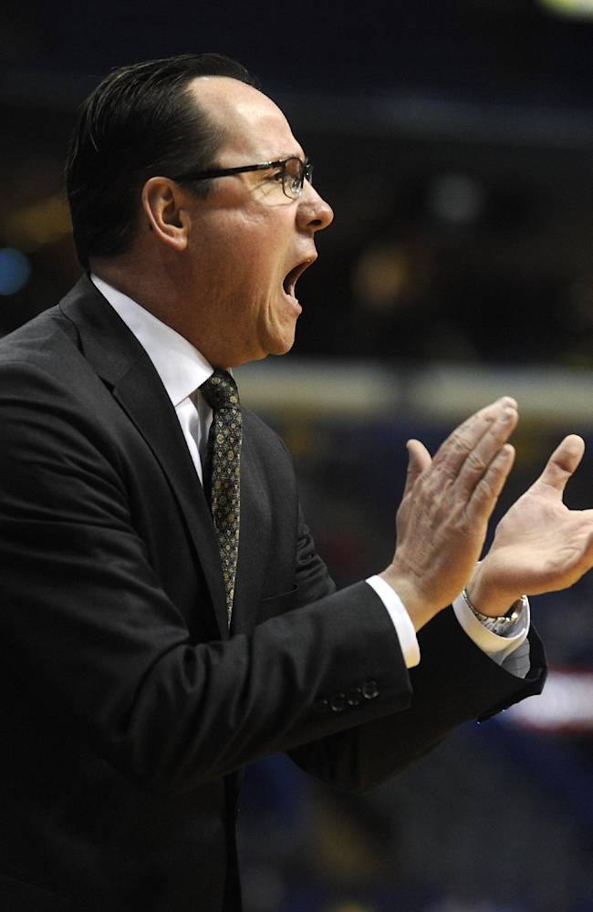 Wichita State's head coach Gregg Marshall cheers his team against Evansville in the first half of an NCAA college basketball game in the quarterfinals of the Missouri Valley Conference men's tournament, Friday, March 7, 2014  in St. Louis