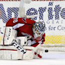 Washington Capitals goalie Braden Holtby (70) reacts after a goal by Ottawa Senators center Zack Smith in the third period of an NHL hockey game, Wednesday, Nov. 27, 2013, in Washington. The Senators won 6-4 The Associated Press