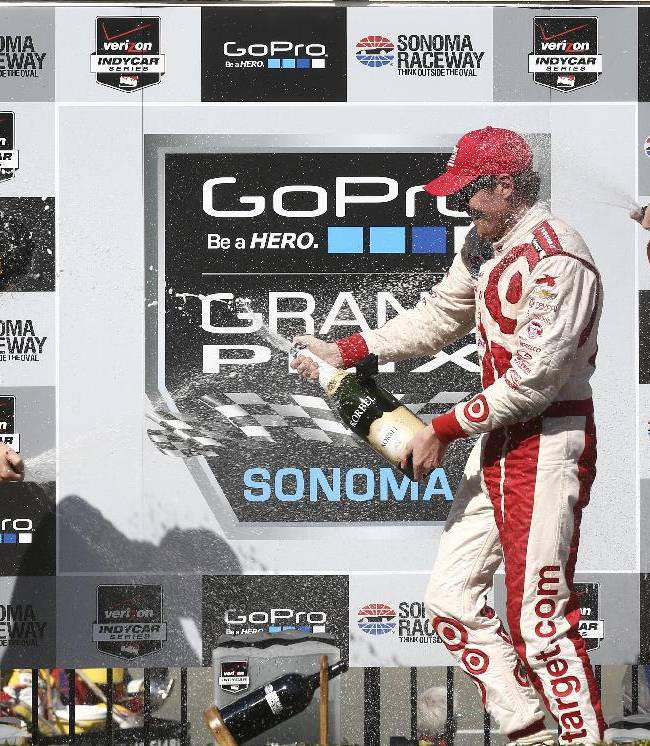 The three winners of the GoPro Grand Prix of Sonoma IndyCar series auto race spray each other with champagne following the race on Sunday, Aug. 24, 2014, in Sonoma, Calif. From left: Second place winner Ryan Hunter-Reay, first place winner Scott Dixon, and third place winner Simon Pagenaud