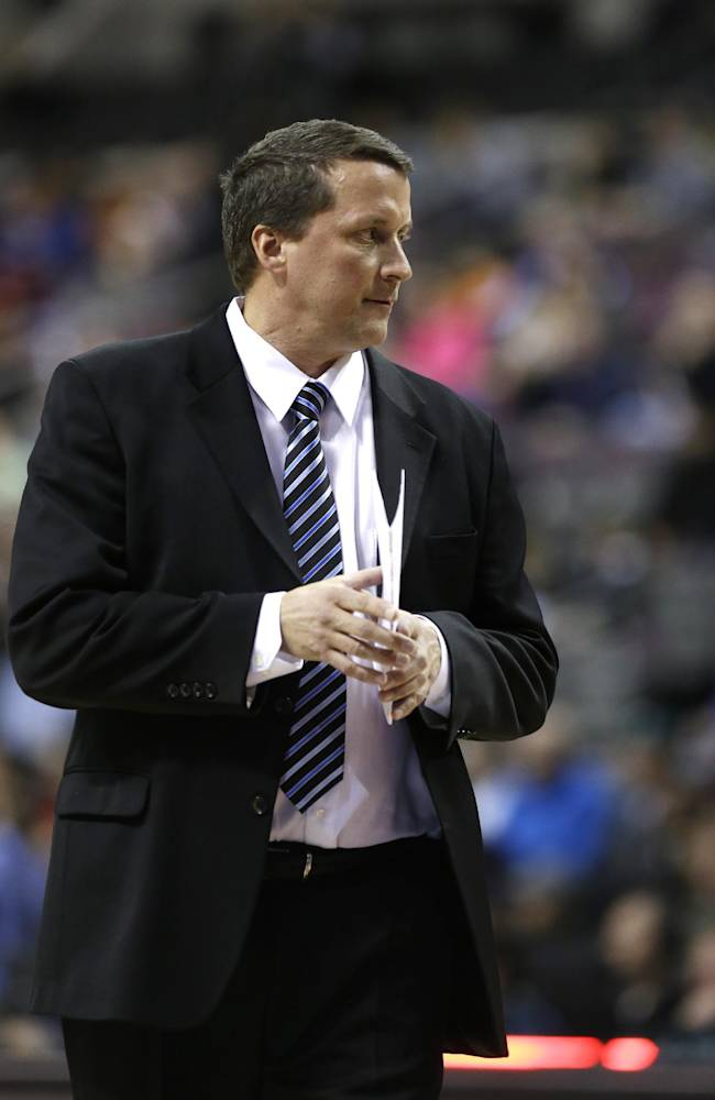 Detroit Pistons interim head coach John Loyer stands on the sideline the first half of an NBA basketball game against the San Antonio Spurs in Auburn Hills, Mich., Monday, Feb. 10, 2014
