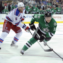 Dallas Stars left wing Ryan Garbutt (16) skates past New York Rangers defenseman Dan Girardi (5) during the first period of an NHL hockey game, Thursday Nov. 21, 2013 in Dallas The Associated Press