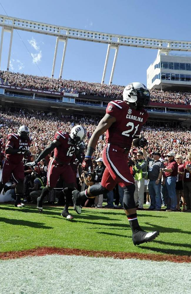 South Carolina wide receiver Andrew Bunch (21) leads his team on to the field for an NCAA college football game against Mississippi State, Saturday, Nov. 2, 2013, in Columbia, S.C