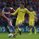 Chelsea's Oscar, right, competes for the ball with Crystal Palace's Mile Jedinak during their English Premier League soccer match at Selhurst Park, London, Saturday, Oct. 18, 2014
