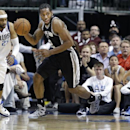 San Antonio Spurs forward Kawhi Leonard (2) comes up with a loose ball against Dallas Mavericks guard Jose Calderon, right, and guard Vince Carter during the first half an NBA basketball game Thursday, April 10, 2014, in Dallas The Associated Press