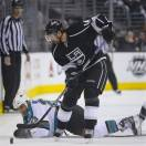 San Jose Sharks center Scott Gomez (23) falls to the ice as he battles for the puck against Los Angeles Kings right wing Justin Williams (14) in the first period during Game 5 of the Western Conference semifinals in the NHL hockey Stanley Cup playoffs, Thursday, May 23, 2013, in Los Angeles. (AP Photo/Mark J. Terrill)