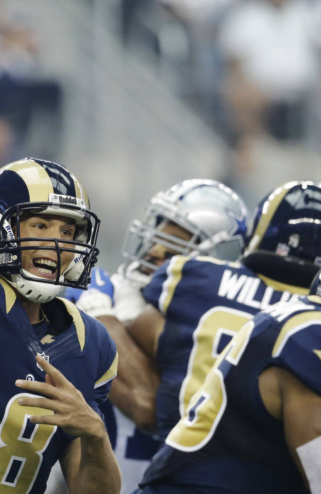 Murray, Romo lead Cowboys to 31-7 rout of Rams