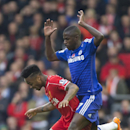 Liverpool's Raheem Sterling, let, fights for the ball against Chelsea's Ramires during the English Premier League soccer match between Liverpool and Chelsea at Anfield Stadium, Liverpool, England, Saturday Nov. 8, 2014