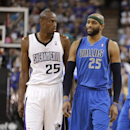 Dallas Mavericks guard Vince Carter, right, smiles as he walks next to Sacramento Kings forward Travis Outlaw in the closing moments of the Mavericks' 93-91 win in an NBA basketball game, Sunday, April 6, 2014, in Sacramento, Calif The Associated Press