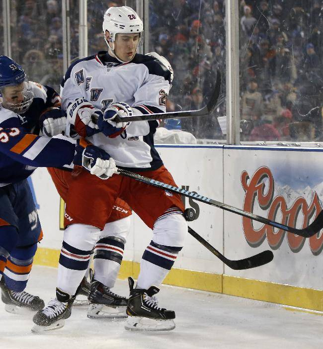 New York Islanders center Casey Cizikas (53) and New York Rangers left wing Chris Kreider (20) go for a puck behind the Islanders net in the second period of an outdoor NHL hockey game at Yankee Stadium in New York, Wednesday, Jan. 29, 2014