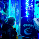 Vancouver Canucks' goalie Eddie Lack, of Sweden, walks back onto the ice after being named first star of the game after defeating the Calgary Flames 2-1 during an NHL hockey game in Vancouver, British Columbia on Saturday March 8, 2014 The Associated Pres