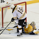 Nashville Predators goalie Pekka Rinne (35), of Finland, blocks a shot by Boston Bruins right wing Reilly Smith (18) during a shootout at an NHL hockey game Tuesday, Dec. 16, 2014, in Nashville, Tenn. The Predators won the shootout to win the game 3-2. Pr