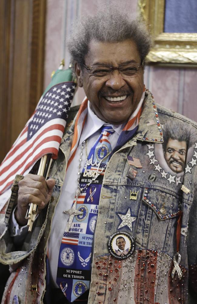 Promoter Don King smiles before being introduced during a news conference Tuesday, Feb. 11, 2014, in Cleveland. King was in Cleveland to promote a boxing event Feb. 21, 2014. The boxing event will feature Angelo Santana (14-1, 11 KOs) vs. Hank Lundy (23-3-1, 11 KOs) in a 10-round lightweight main event